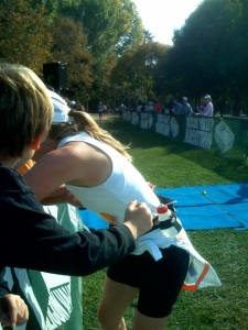 Kissing my three boys just feet from the finish, knowing I smoked my goal by 8 minutes!