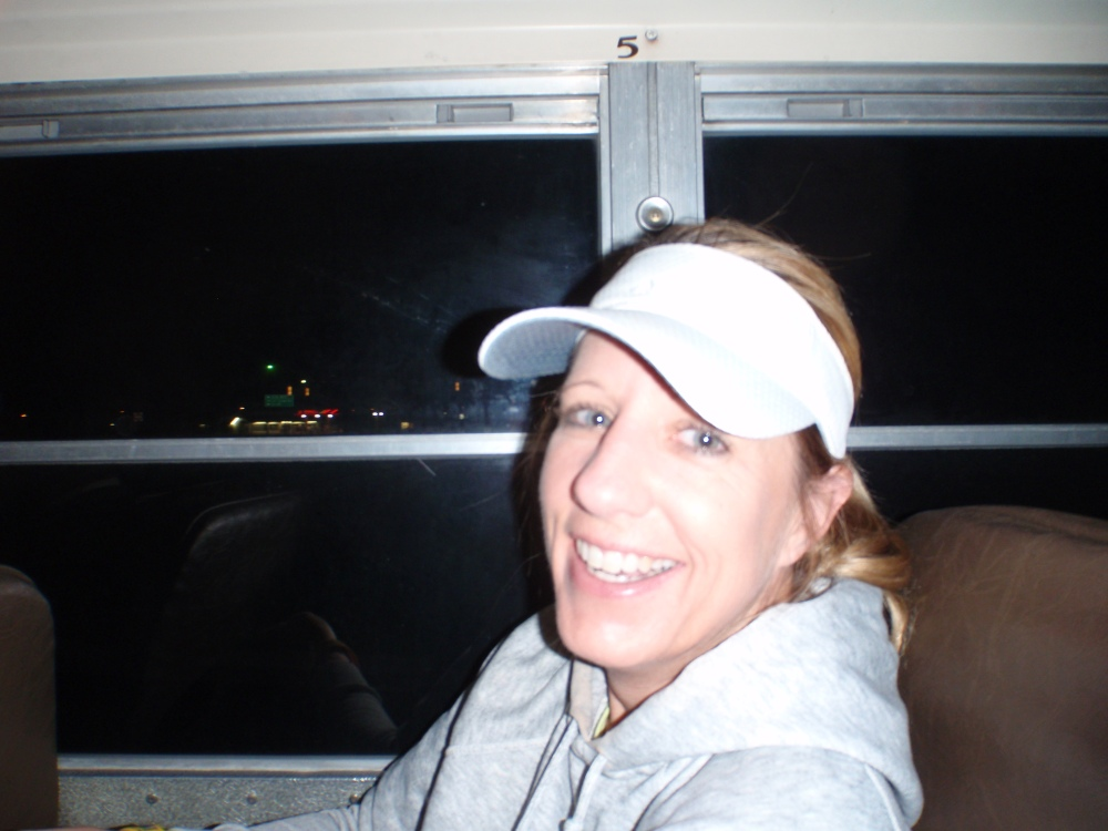 Kim on the bus at 4:30AM - Looking surprisingly happy considering the time!